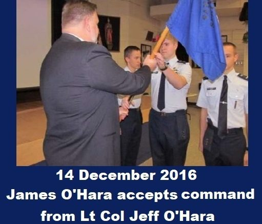 Civil Air Patrol Cadet James H. O'Hara accepts cadet command from Lt Col Jeff O'Hara