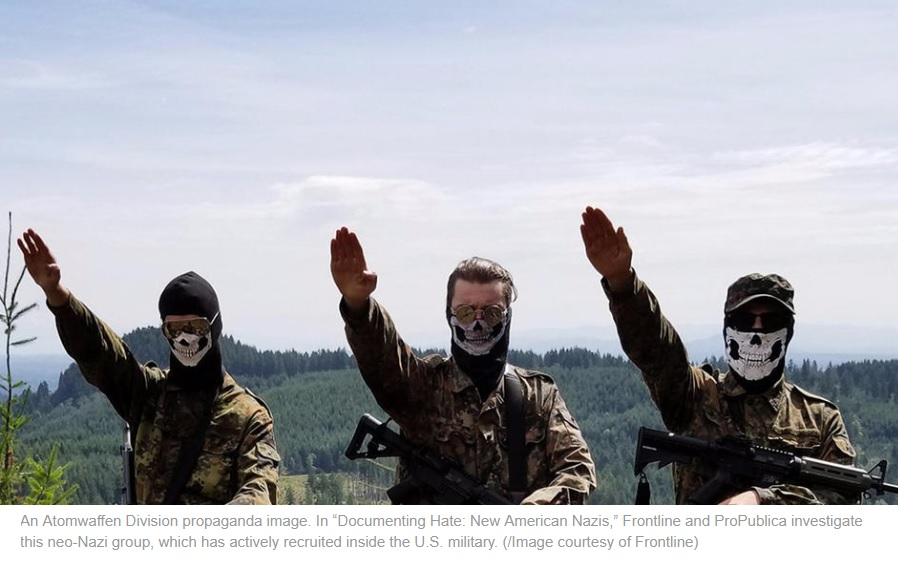 Members of the American Neo-Nazi Atomwaffen Members Salute